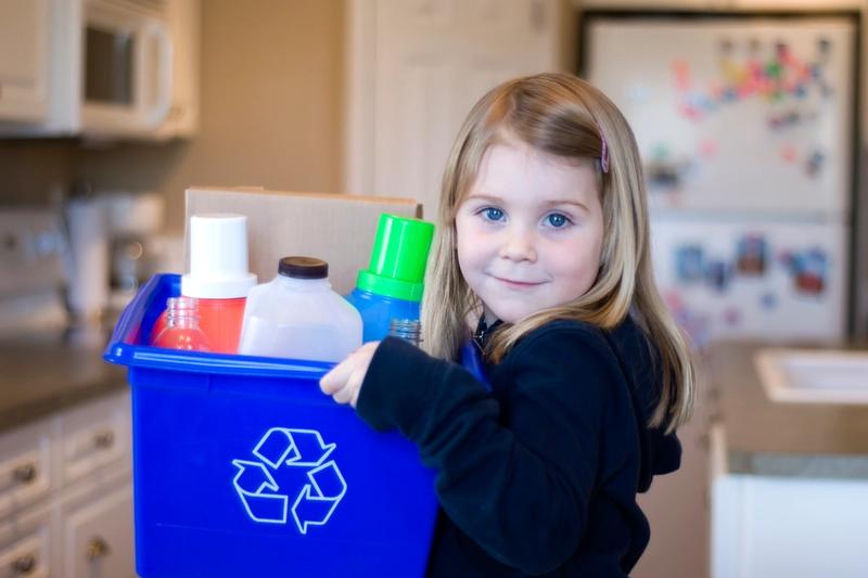 Child sorting recyclable waste