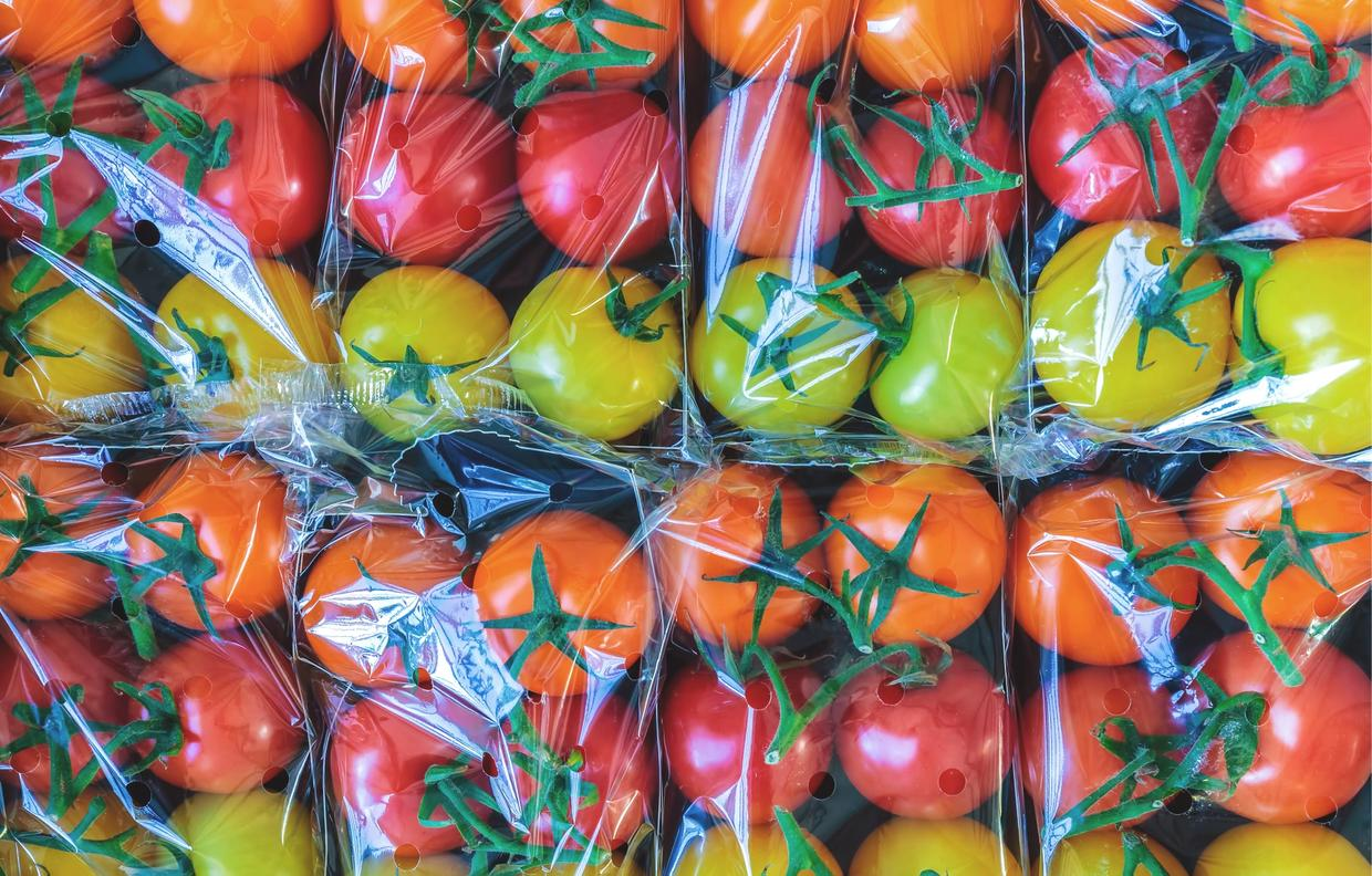 tomatoes wrapped in plastic packaging