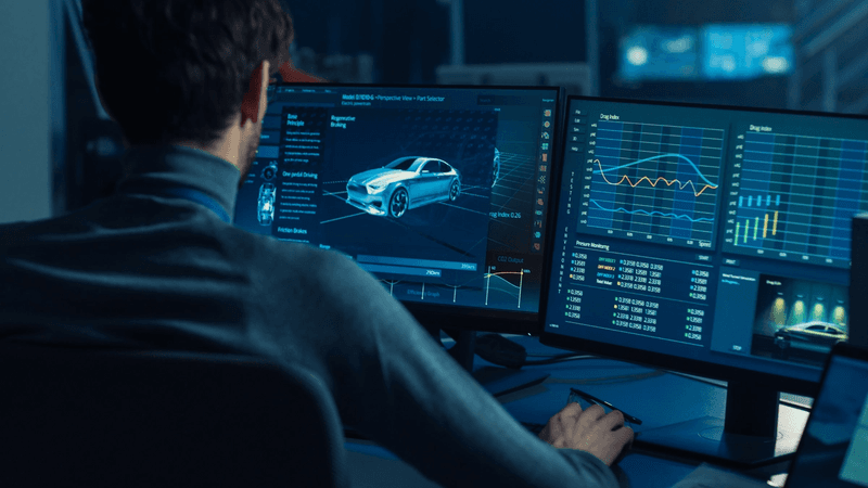 Man at computer working on car concept