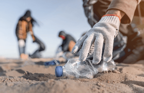 People picking up plastic litter on beach