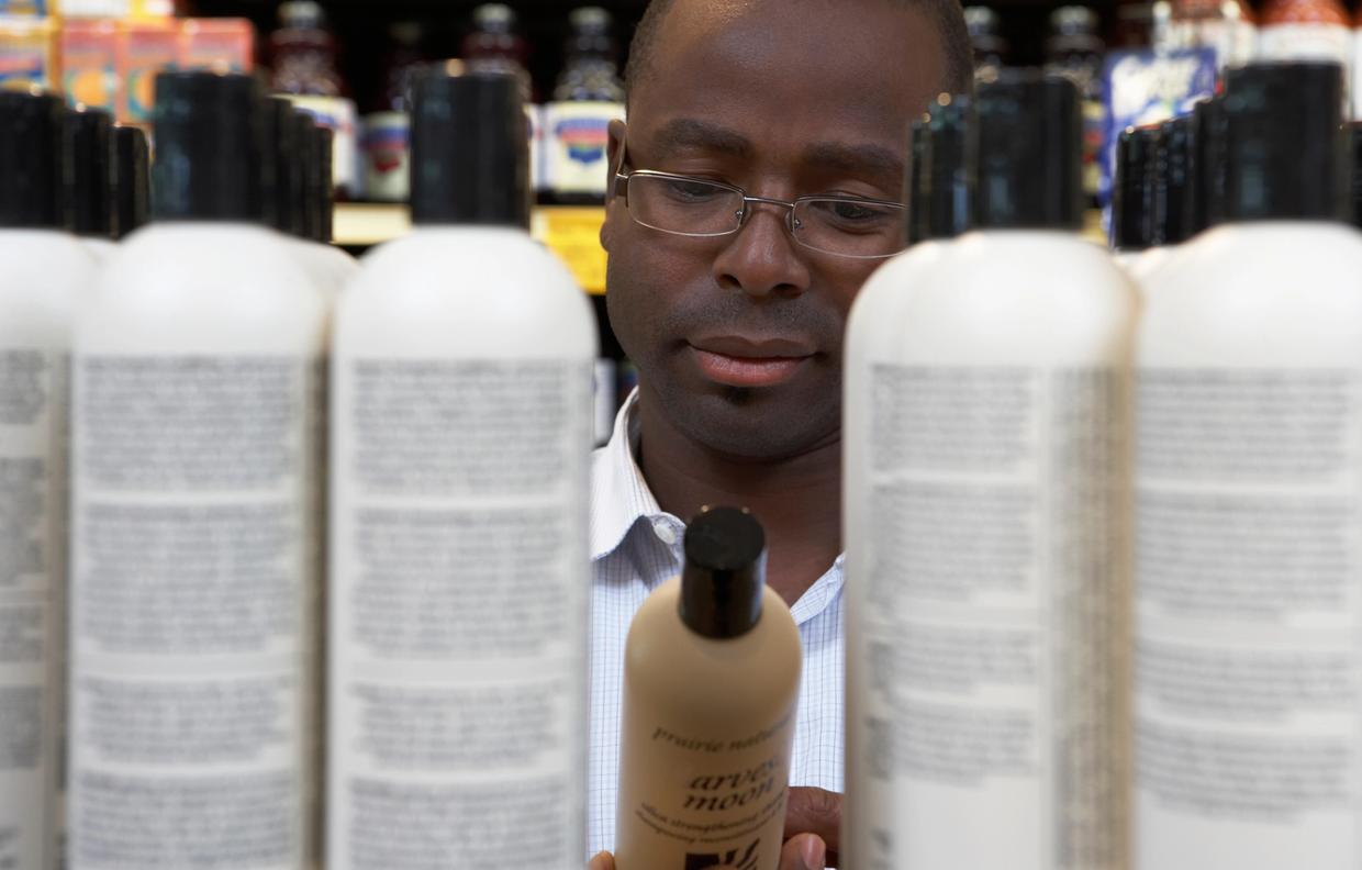 Man shopping for hair care products in store