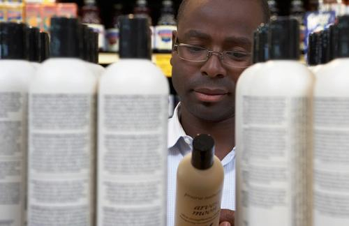 Man looking at hair care products in store