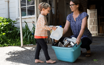 Woman and child collecting recyclables